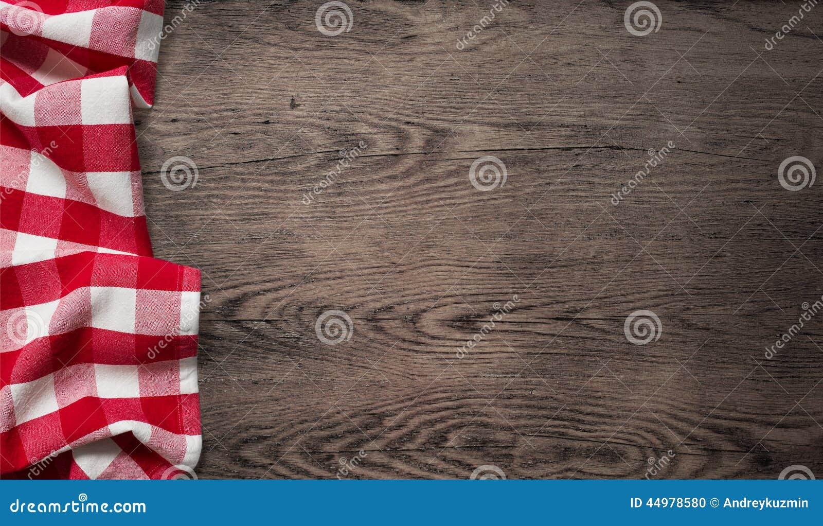 Mantel de la comida campestre en la vieja opinión de sobremesa de madera