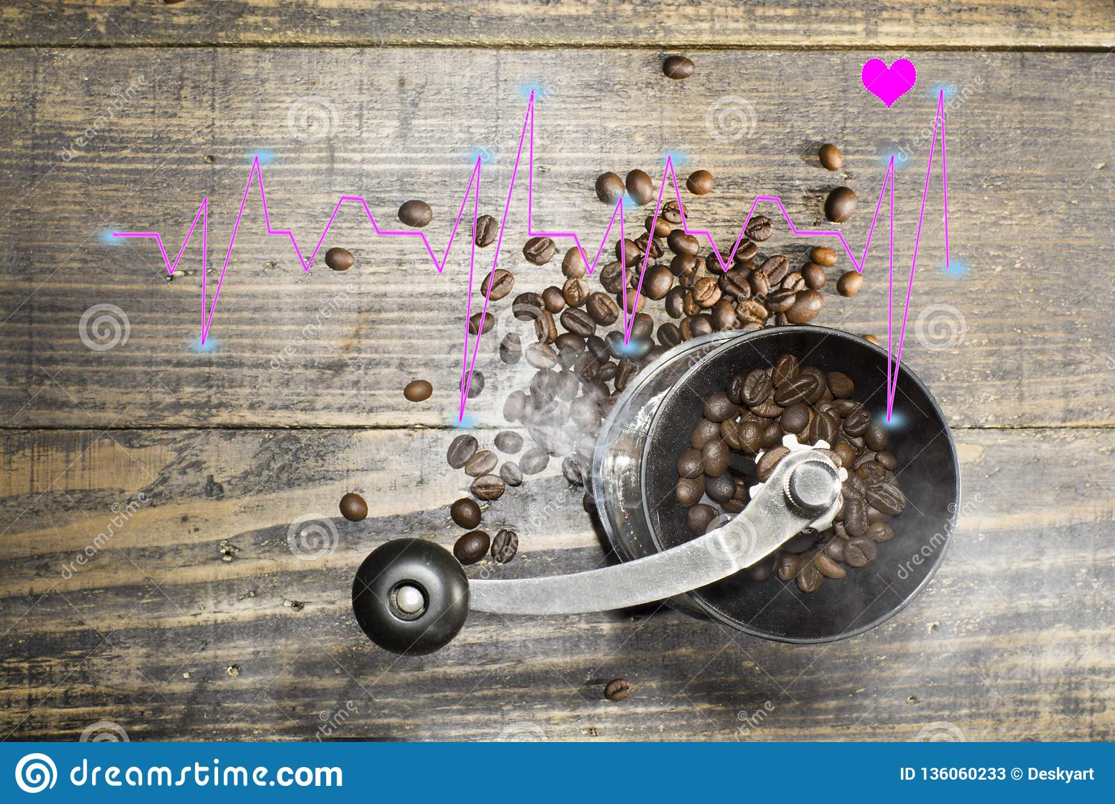 The manual coffee grinder contains coffee beans with a line diagram of the high and low heart beat rate. Heart healthcare concept