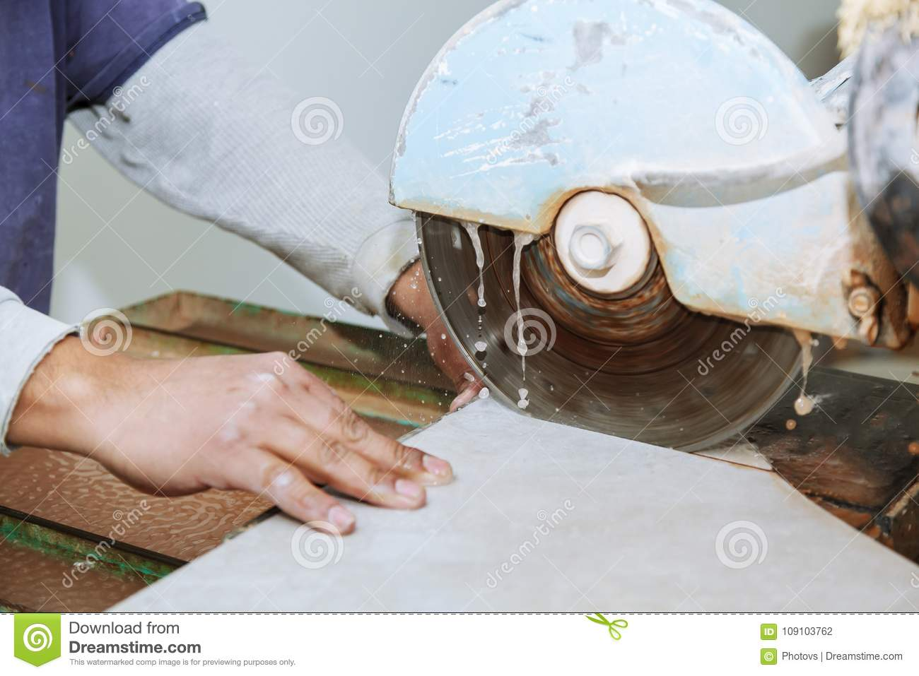 Manual Cutting Of Ceramic Tiles On A Special Machine For Cutting
