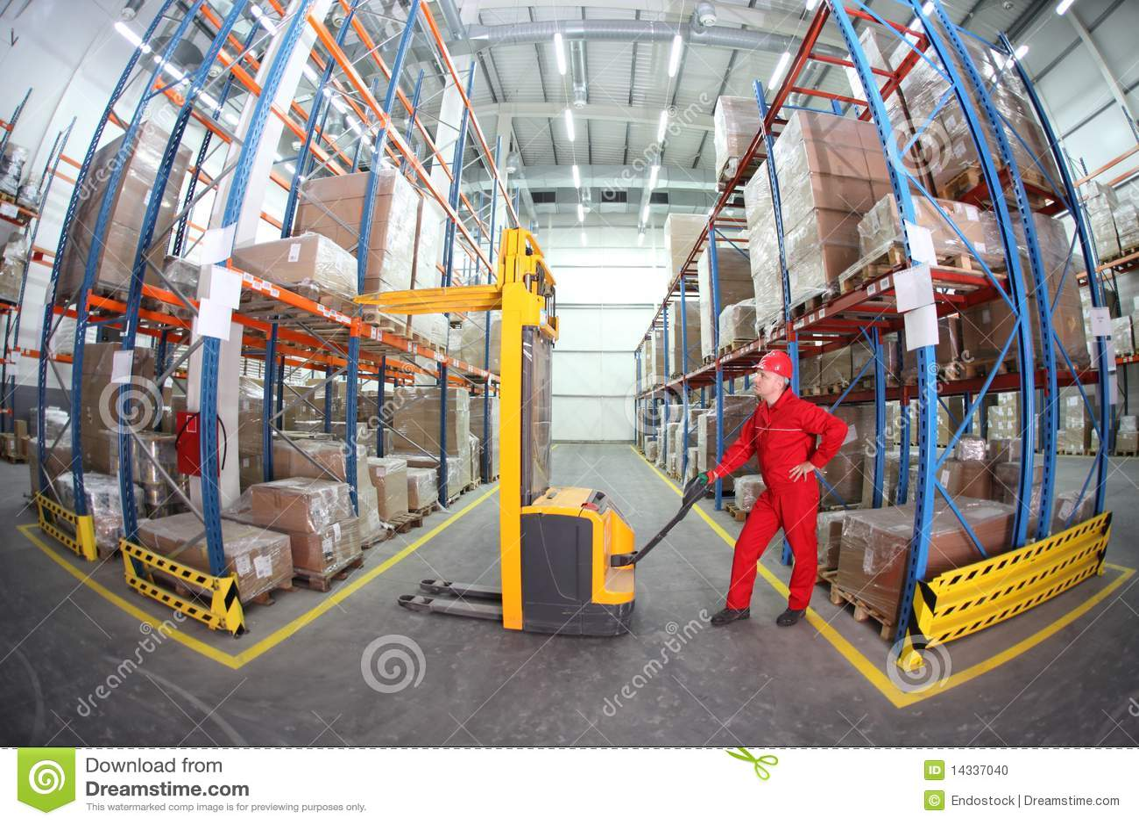 Warehousing - Manual Forklift Operator At Work In Stock Photo ...