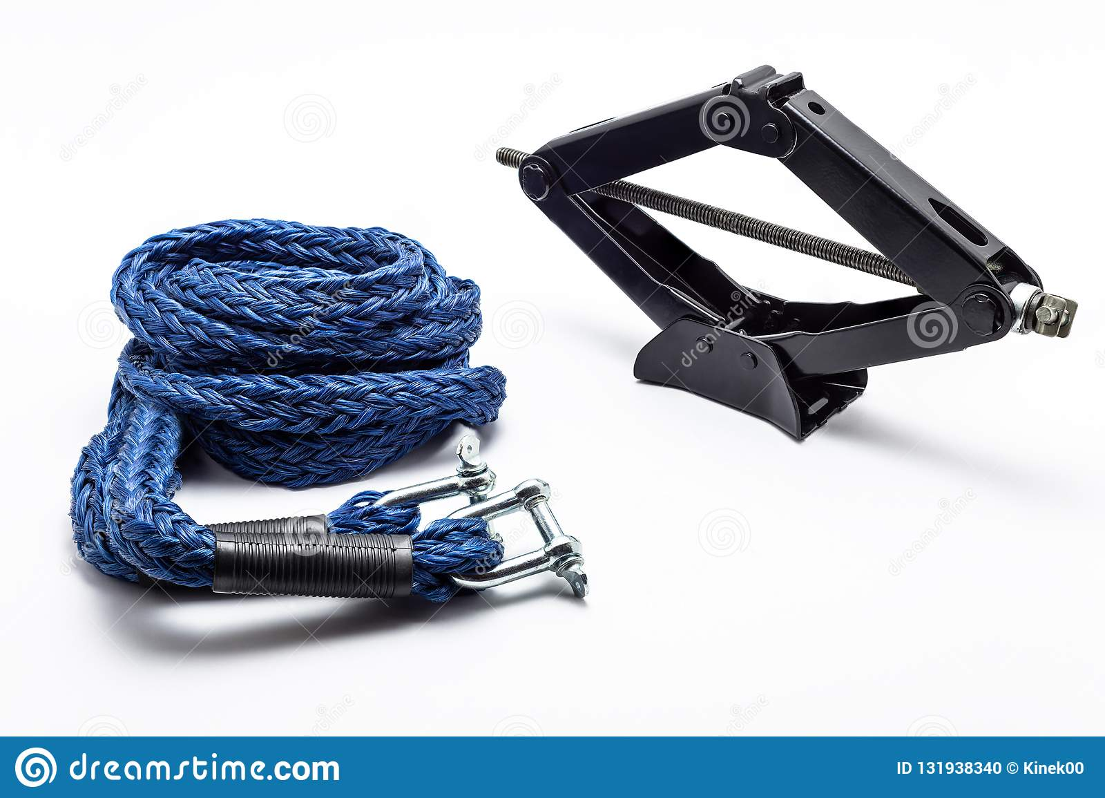 Manual scissor car jack and car tow rope, isolated on a white background with a clipping path.