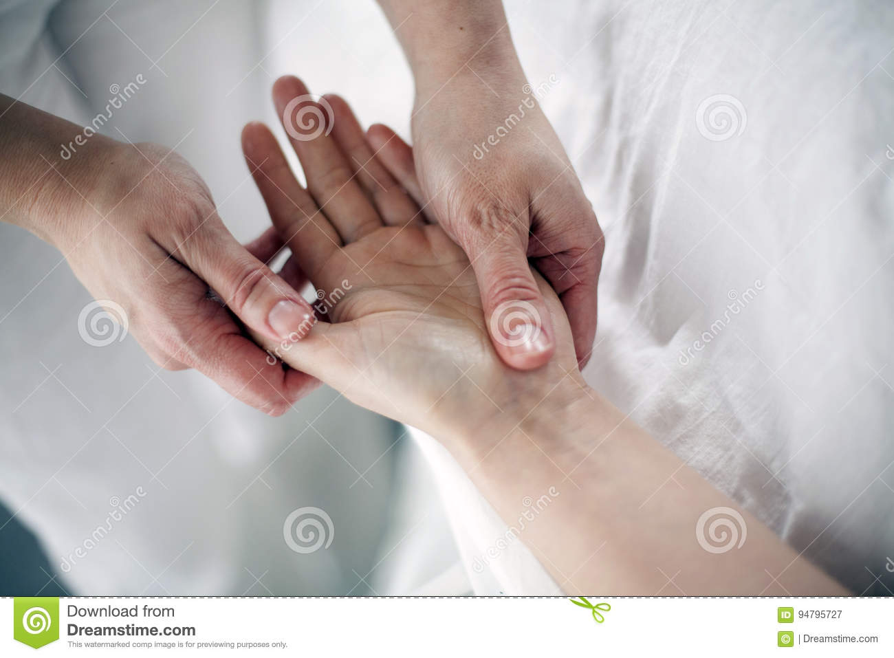 Manual therapy on the palms of the hands
