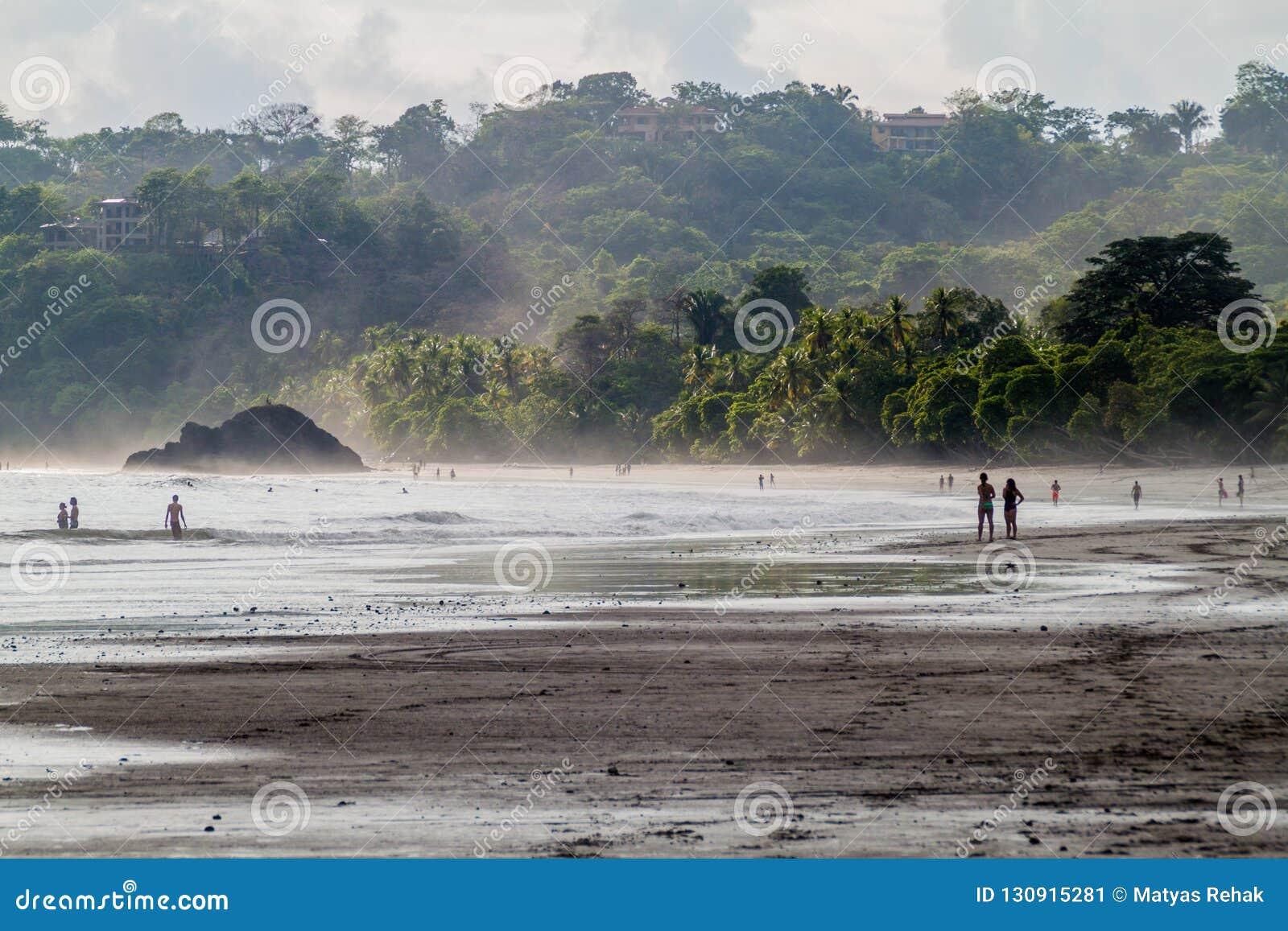 MANUEL ANTONIO, COSTA RICA - MAY 13, 2016: People on a beach in Manuel Antonio village, Costa Ri