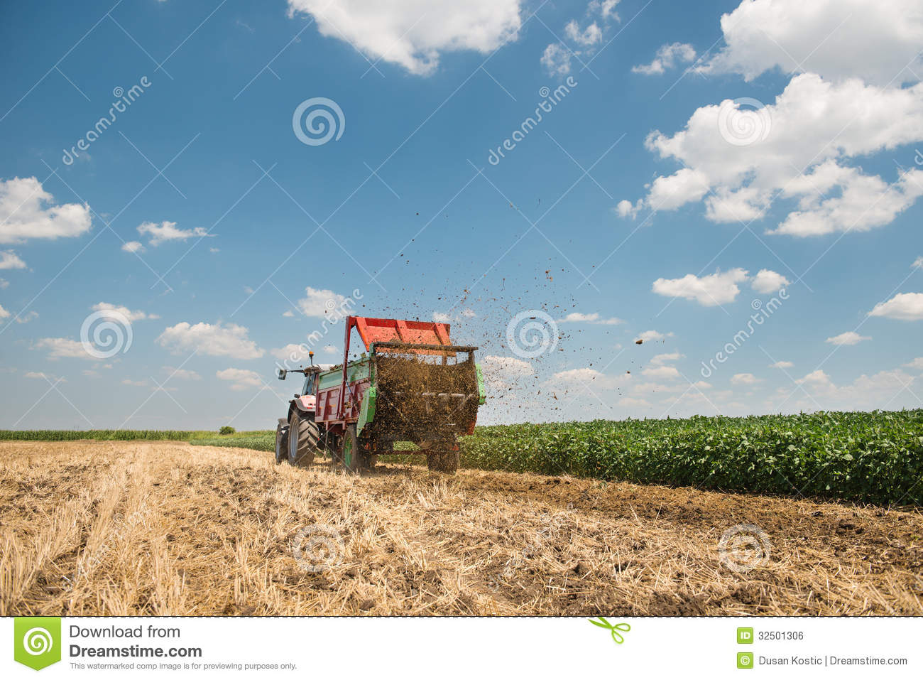 Working Manure Spreader : Manure spreader working royalty free stock image
