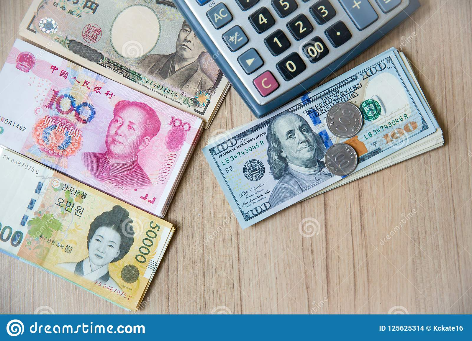 Many Banknote Currency, Yen-Japan,euro-EU,yuan-China, Won-Korea With Calculator And Coins. Image ...