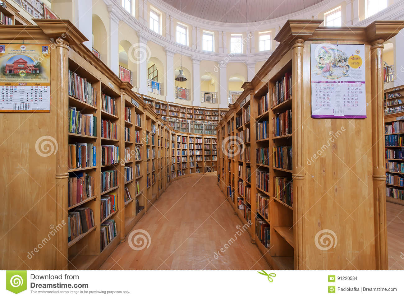 Many Books Stack On Shelves Of The Karnataka State Central Library