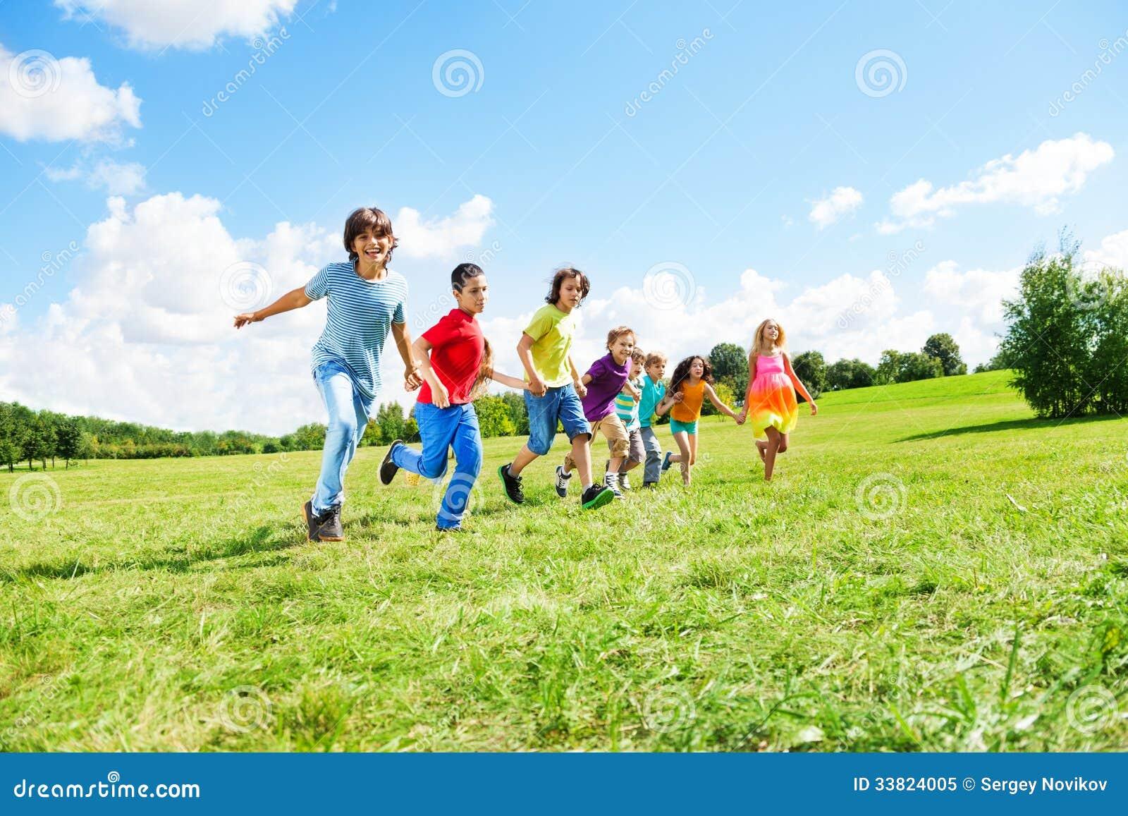 many boys and girls running royalty free stock photo