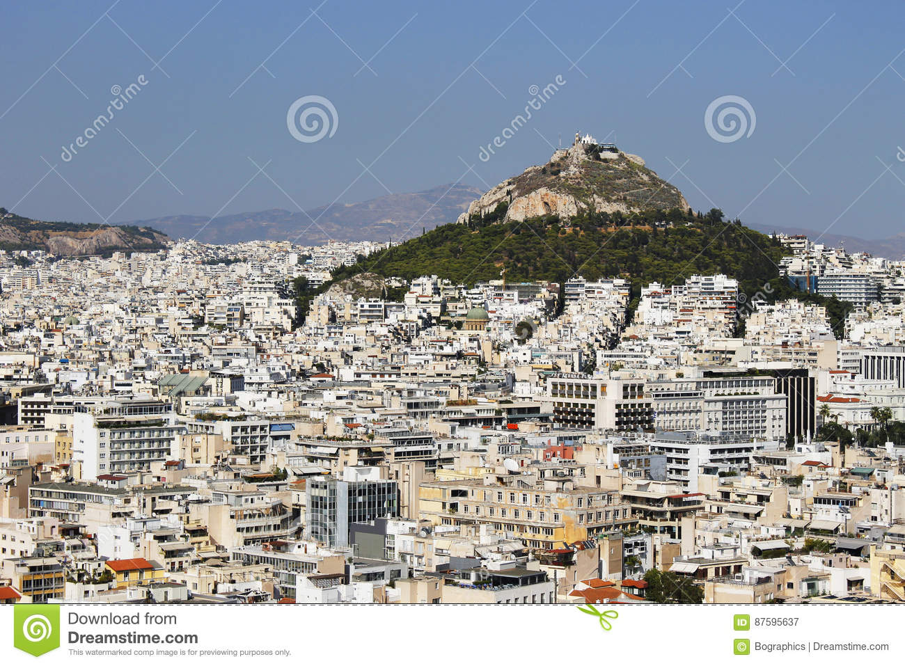 Many buildings and big hilltop in Athens Greece