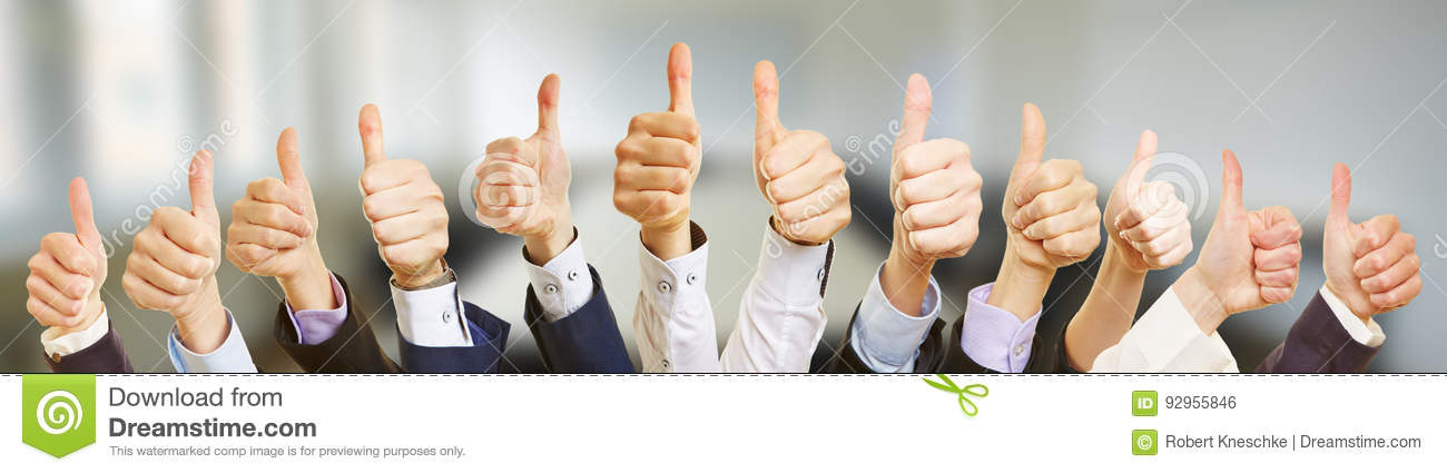 Many business people holding thumbs up