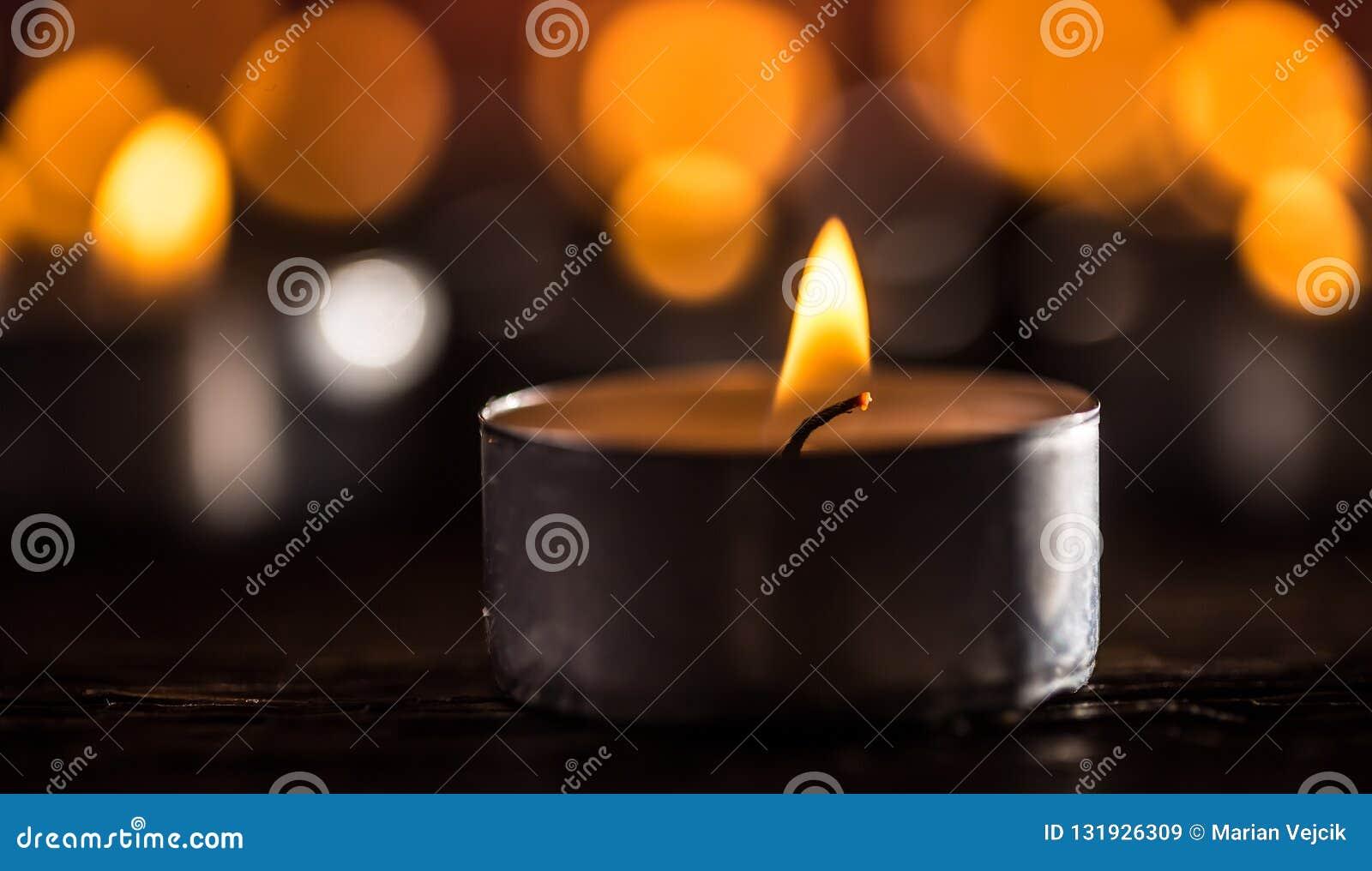 Many candles symolizing funeral religios christmas spa celebration birthday spirituality peace memorial or holiday burning