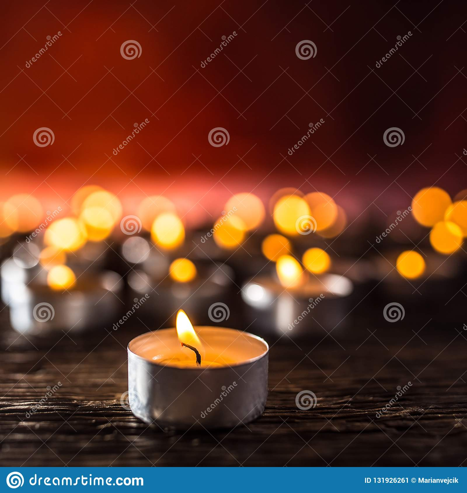 Many candles symolizing funeral religios christmas spa celebration birthday spirituality peace memorial or holiday burning