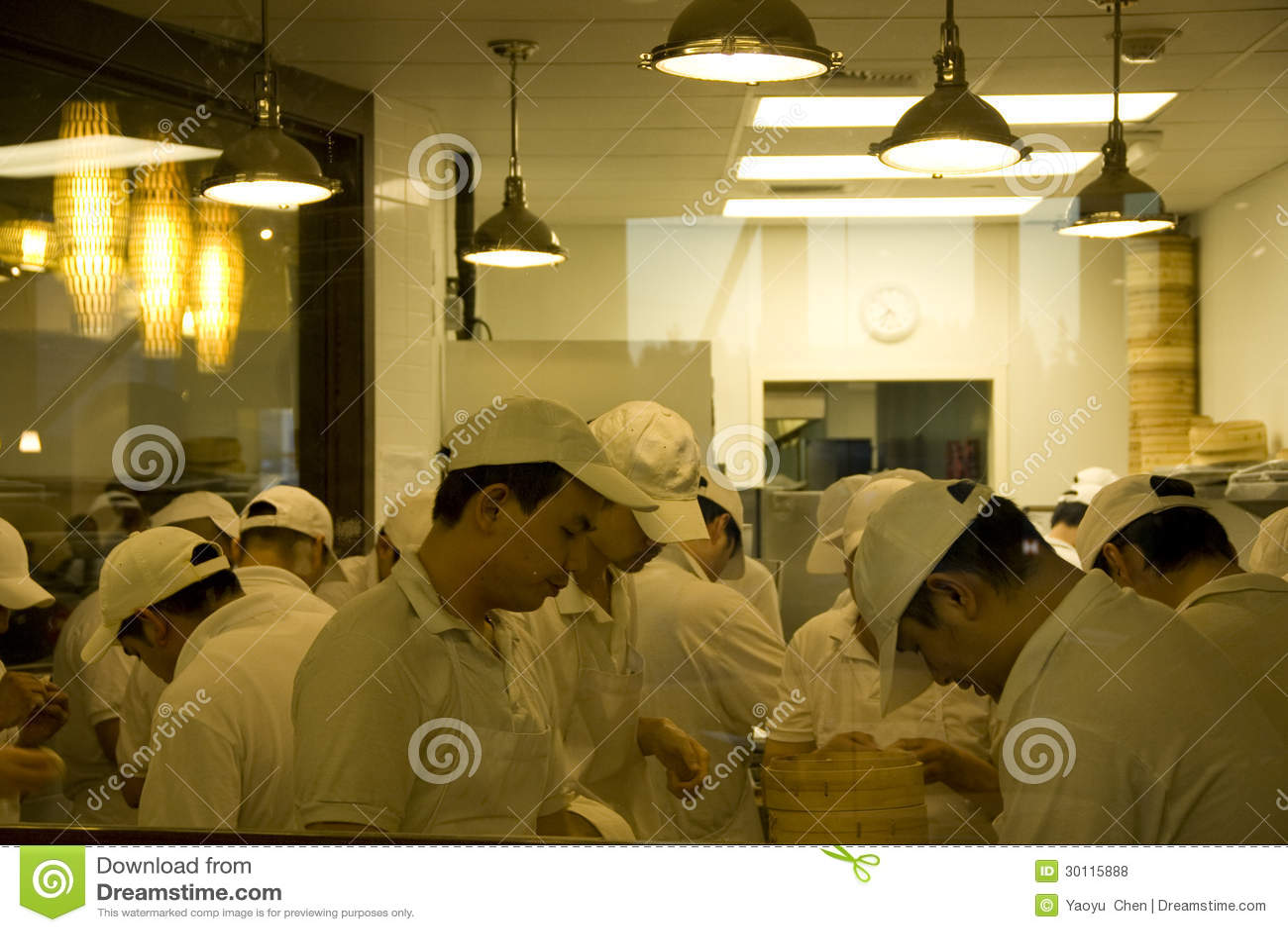 Busy Restaurant Kitchen busy chefs in chinese restaurant kitchen editorial stock photo
