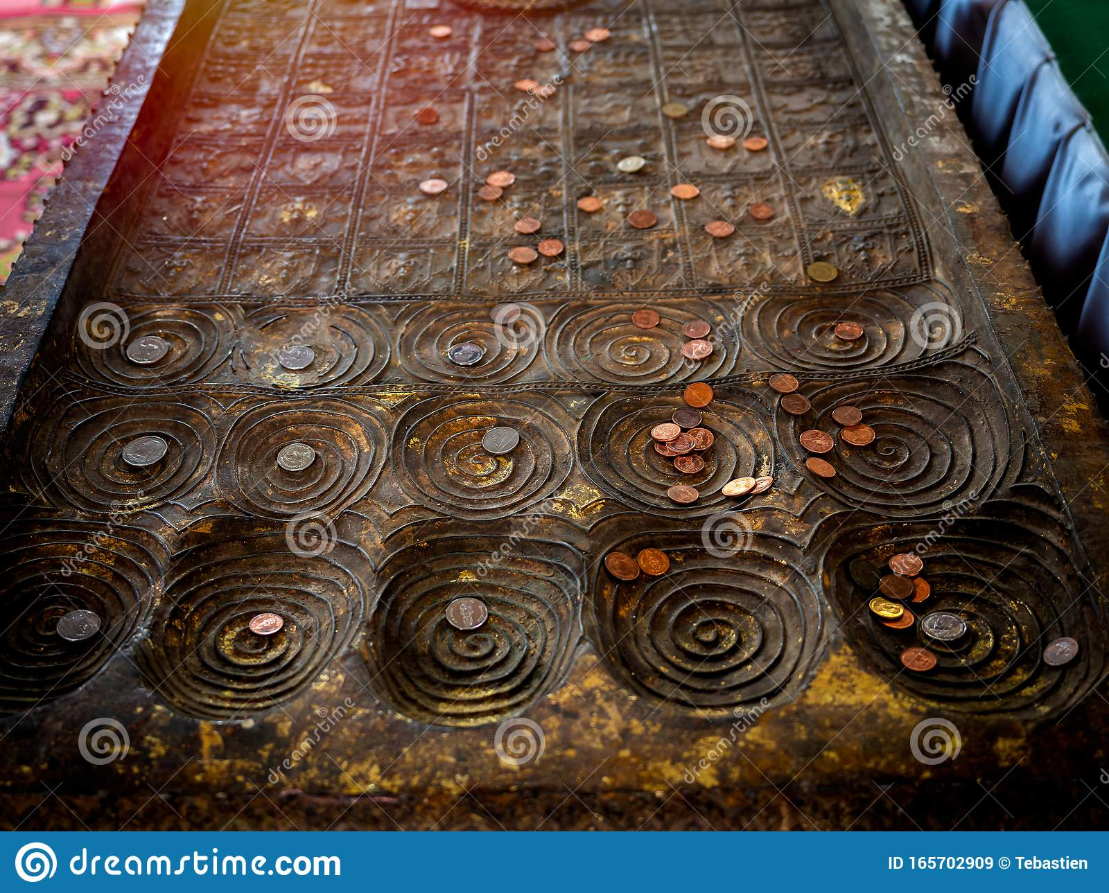 Many Coins Placed On Replica Of Buddha Footprint In The ...