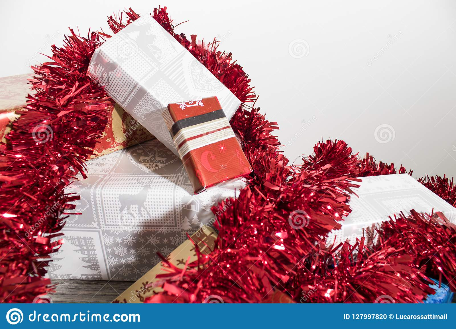 Many colorful christmas gifts with decorations on a wood table