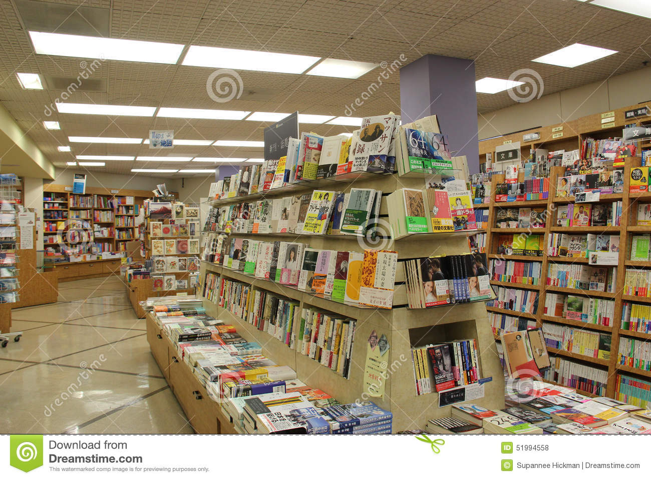 Many Different Books On Wooden Bookcases Editorial Stock
