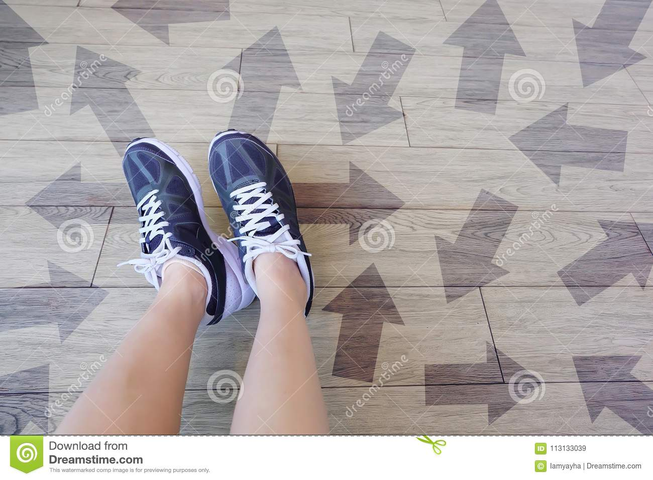 Many Direction Arrow Choices. Selfie of Running Shoes with Drawn Arrows. Woman Violet Sneakers with Decisions on Wooden Floor Back