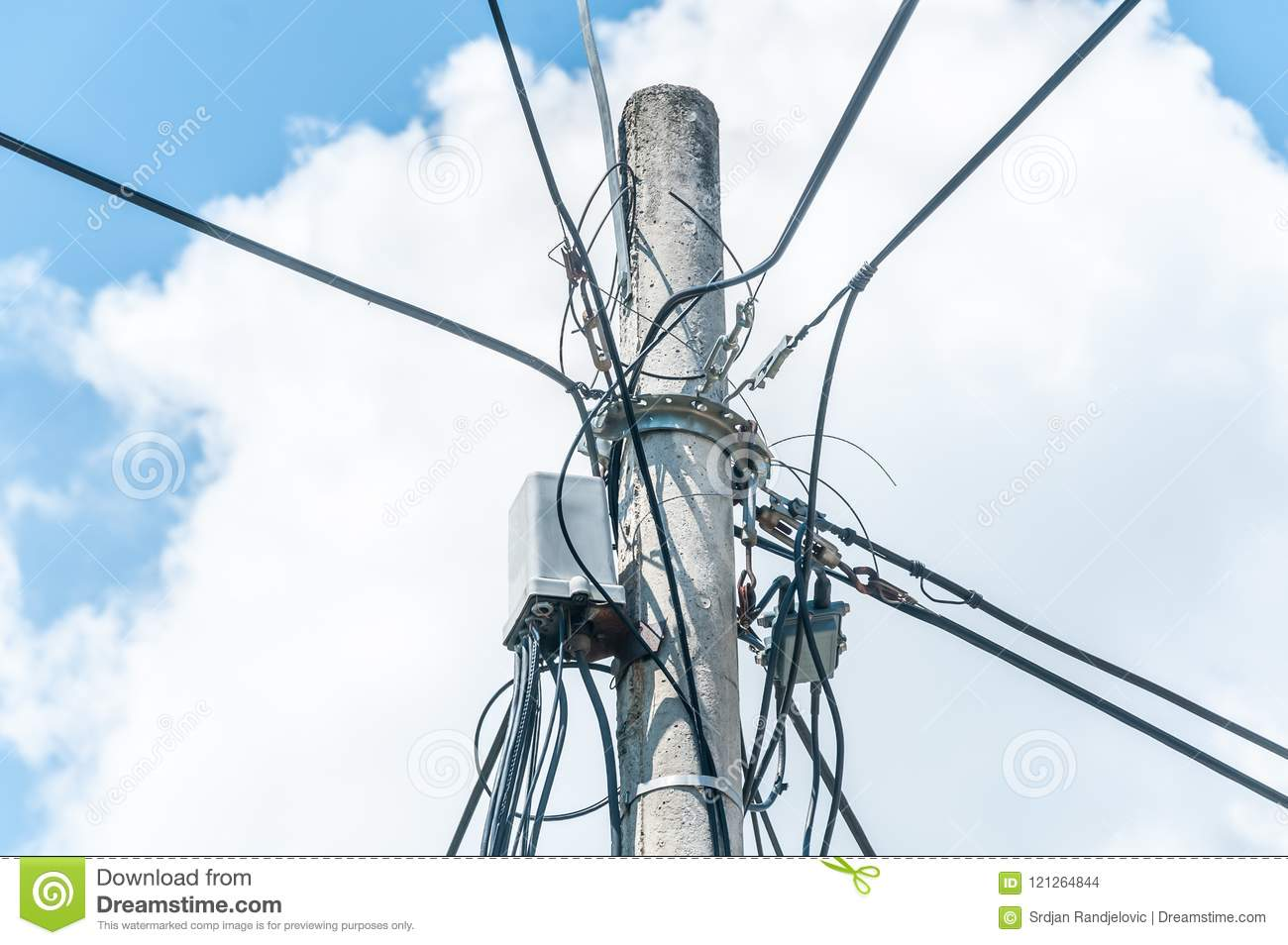 Many Electric Wires On Concrete Street Pole With Internet Or Cell Wiring Phone Box Communication And Blue