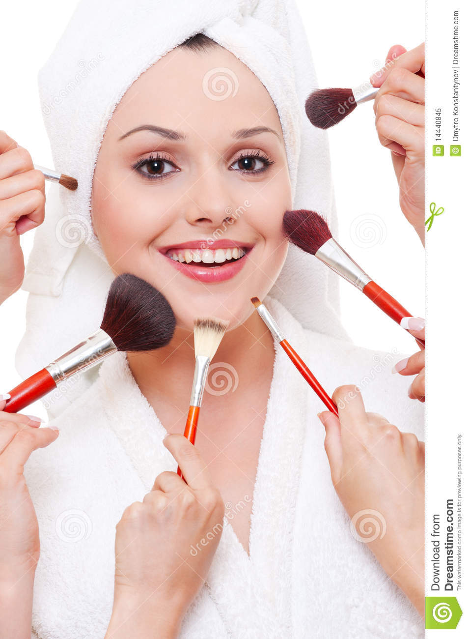 Many Hands Applying Make-up To Beautiful Woman Stock Image