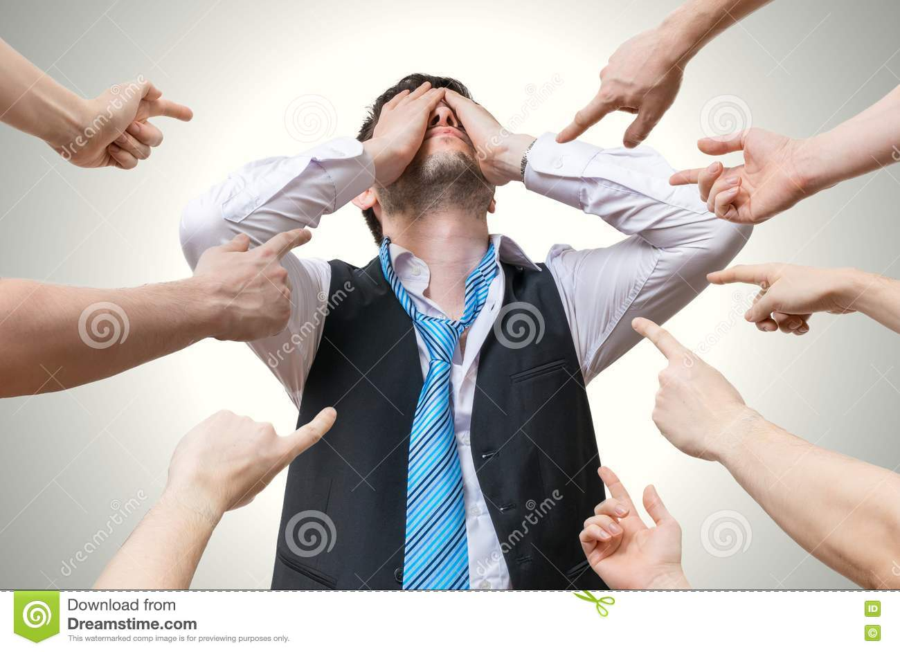 Many hands pointing at disappointed man and blame him