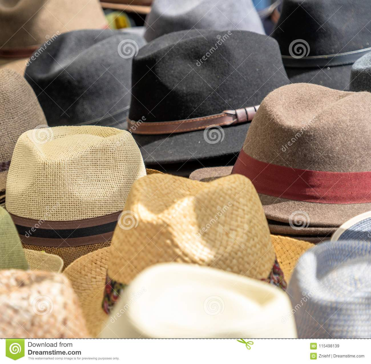 Many hats for men in different shapes and colors in one display for sale 6fbca435a1e7