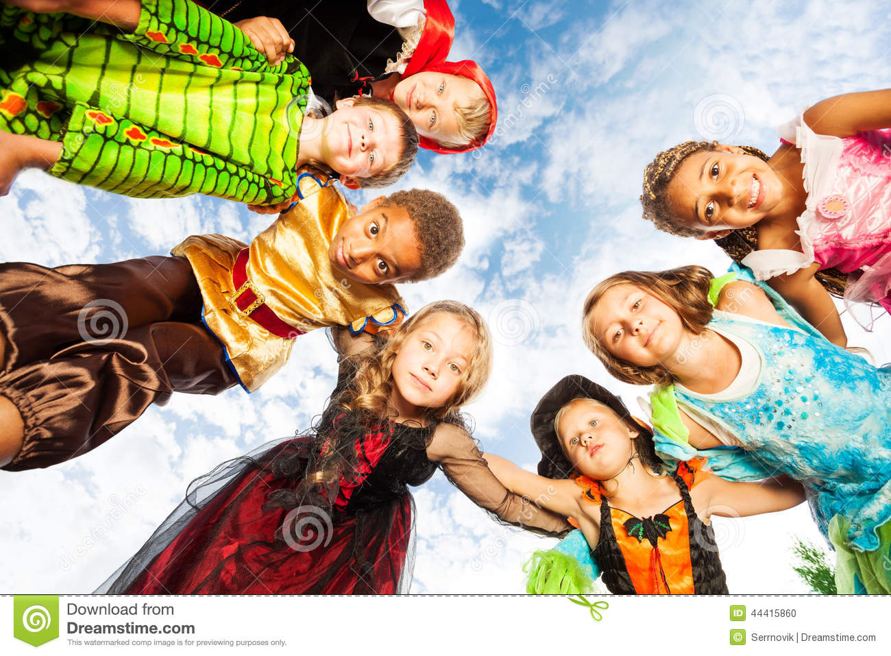 Many Kids Halloween Costumes Look Down In Circle Stock