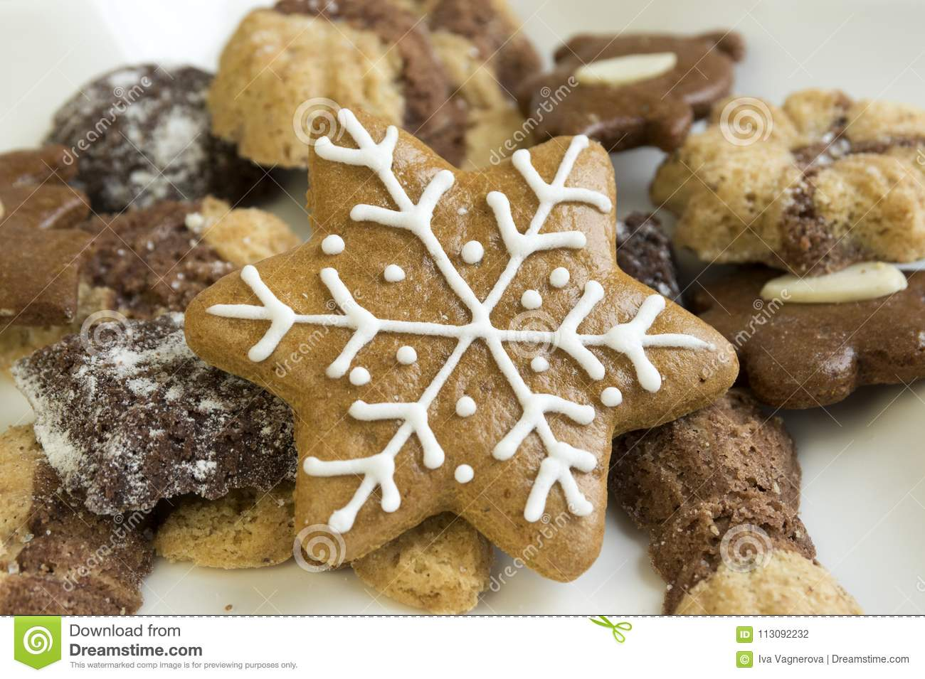 Many Kinds Of Christmas Cookies On White Star Plate Stock Photo