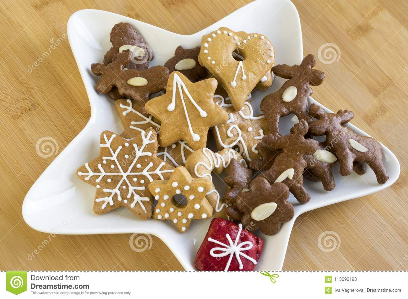 Many Kinds Of Christmas Cookies On White Plate Gingerbread Dark And