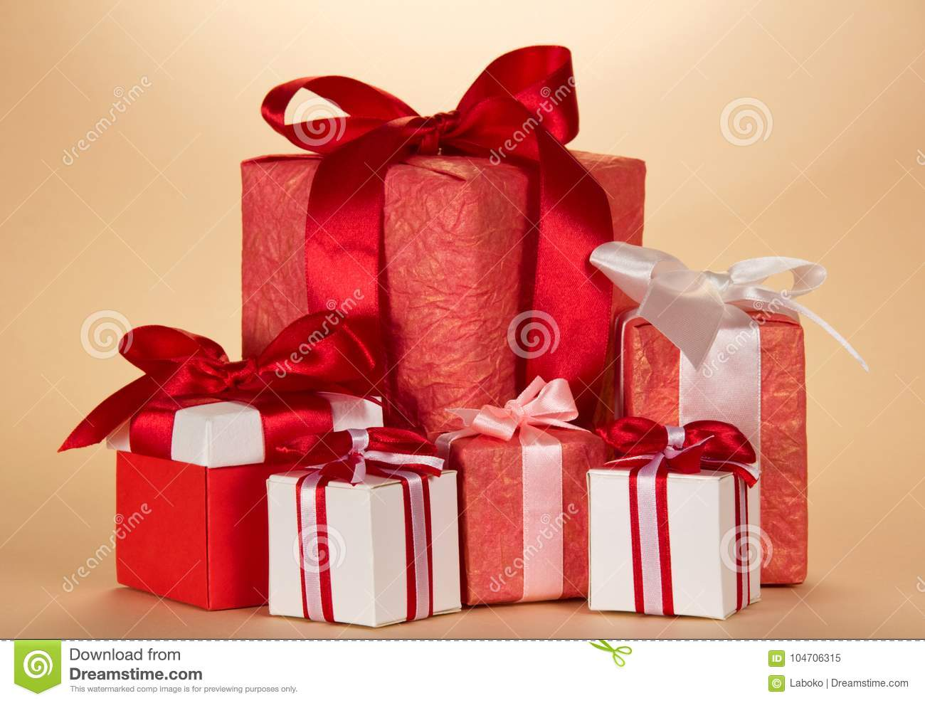 Many Large And Small Christmas Gifts On Beige Stock Image - Image of ...