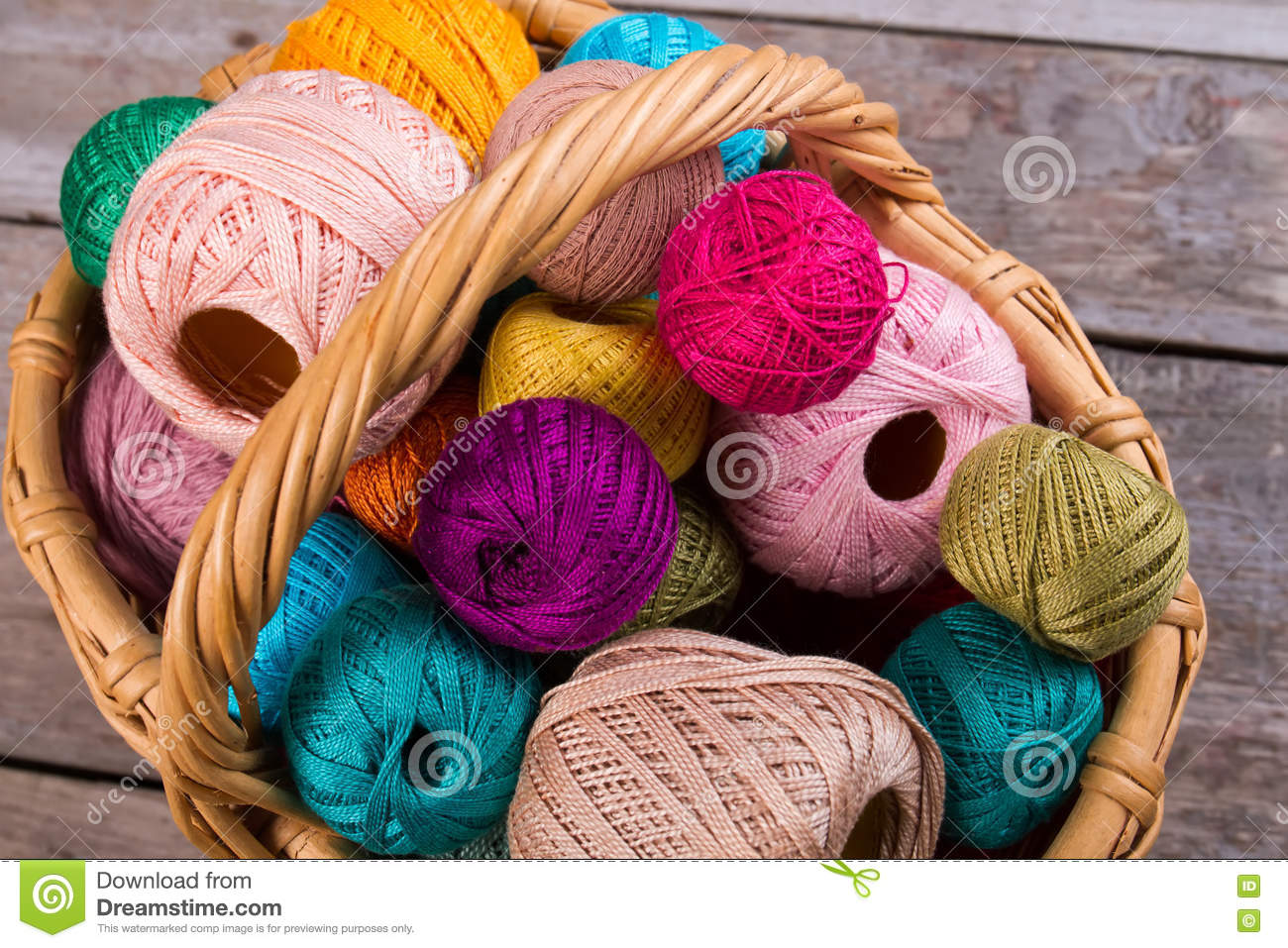 Many multi-colored threads for embroidery and yarn.