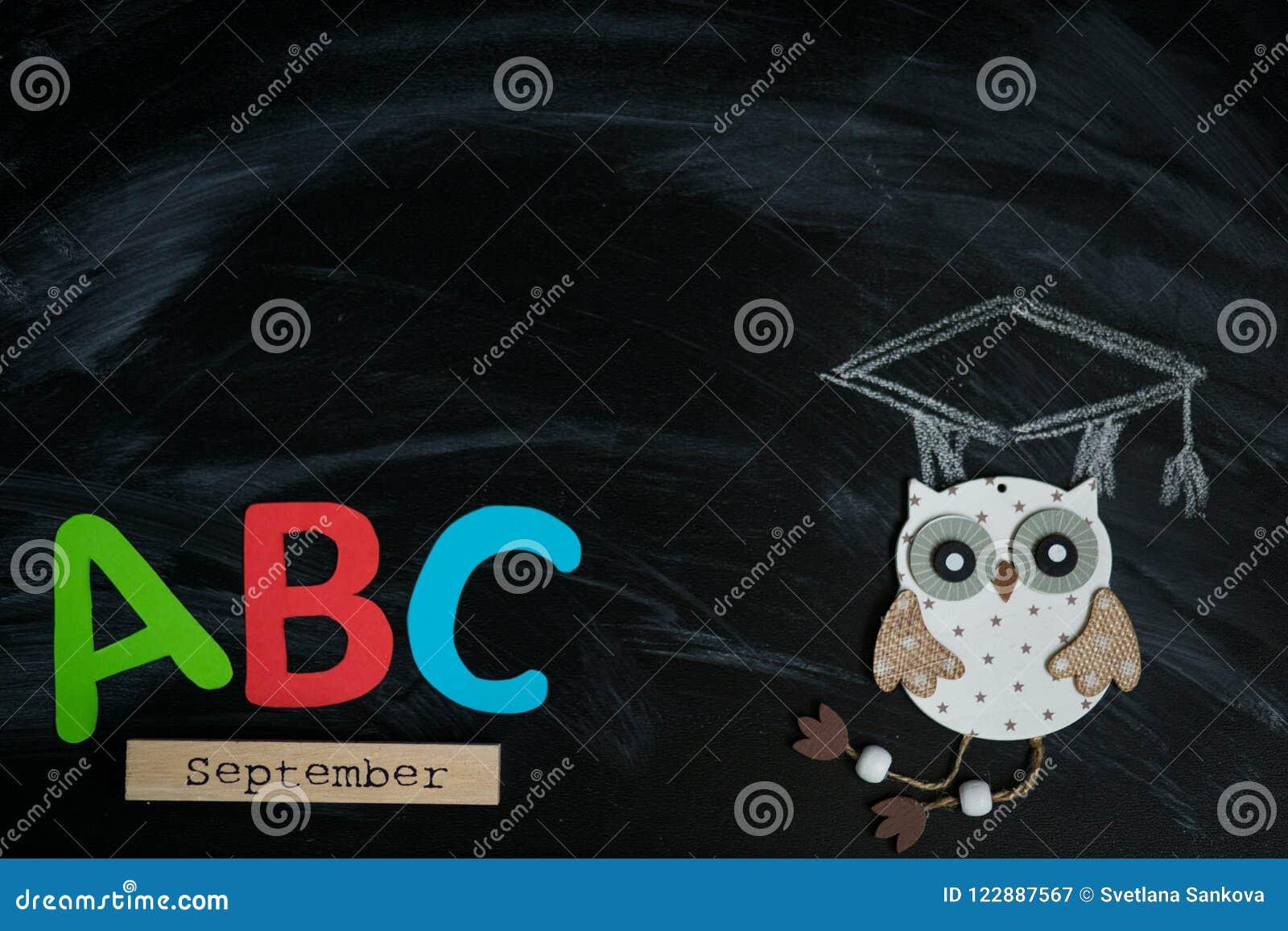Many multicolored letters on blackboard