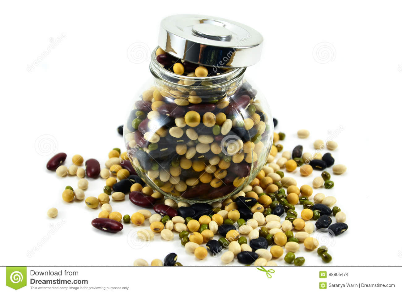 Many nuts overflow from the jar.