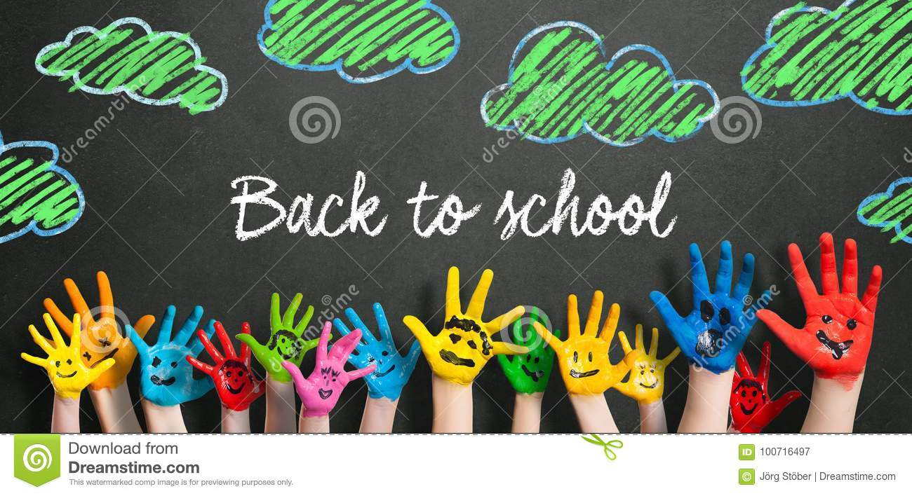 Many painted kids hands with smileys and the message `Back to school`