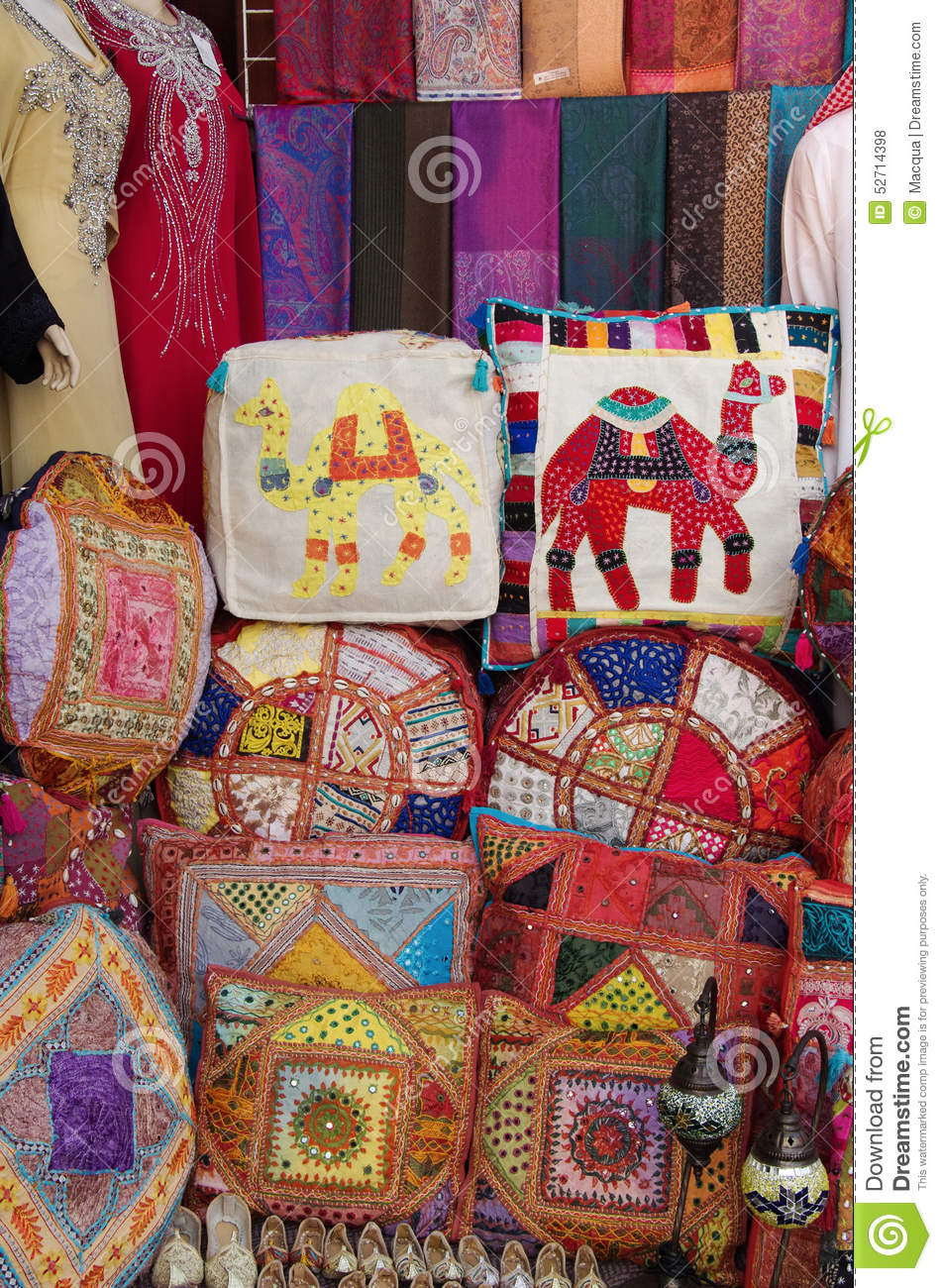 Many patchwork pillows