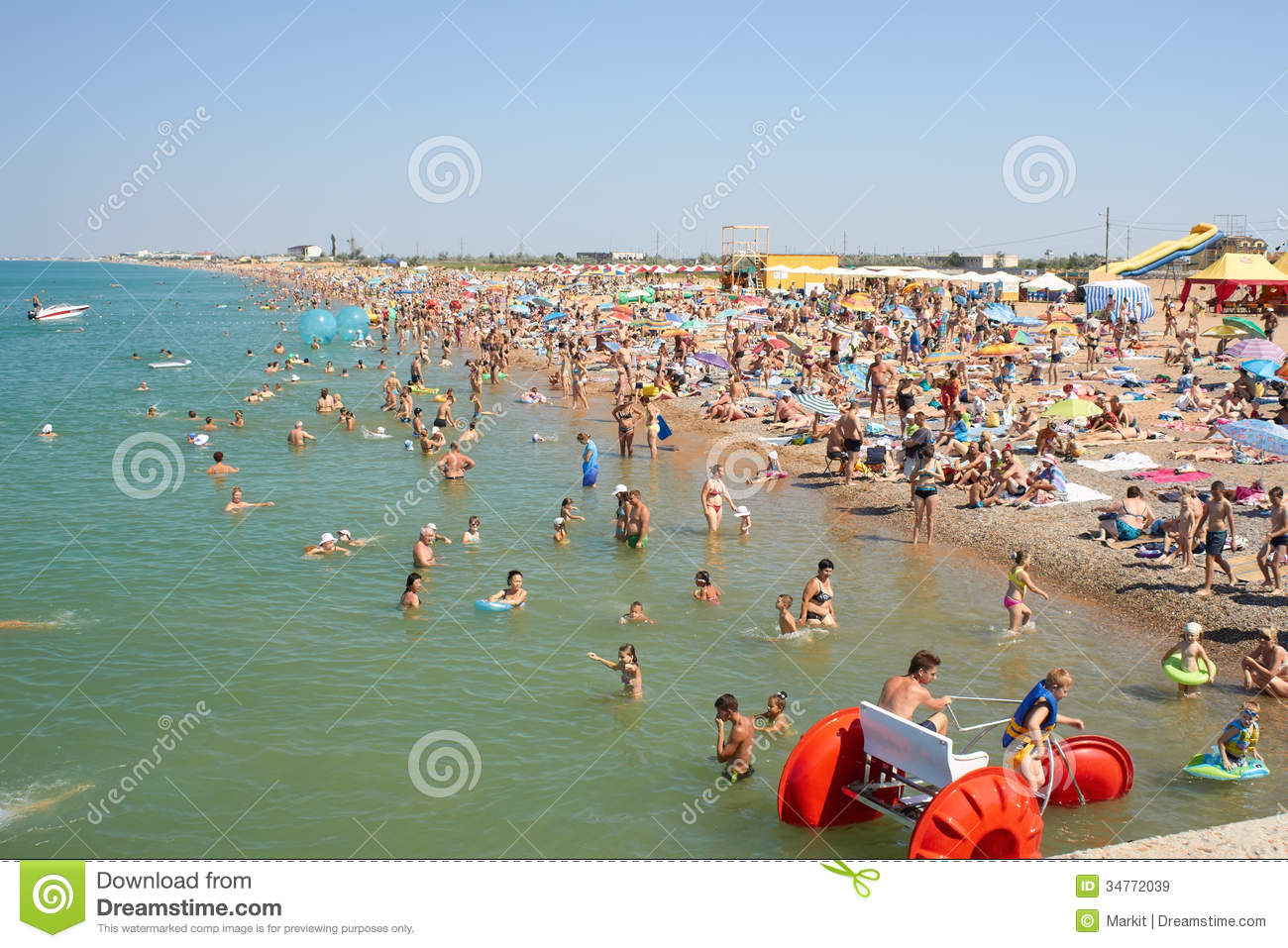 Seascape Beach Resort >> Many People Relaxing On The Beach Editorial Stock Image - Image: 34772039