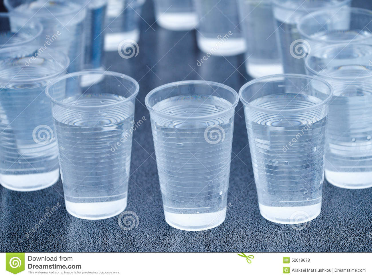 Many plastic cup isolated on gray