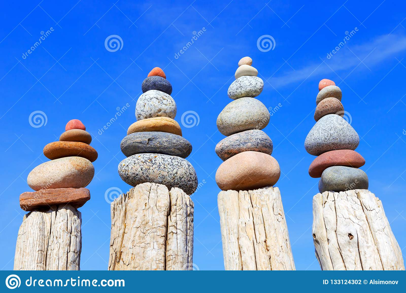 Many of the Rock zen pyramid of white and pink pebbles on a background of blue sky