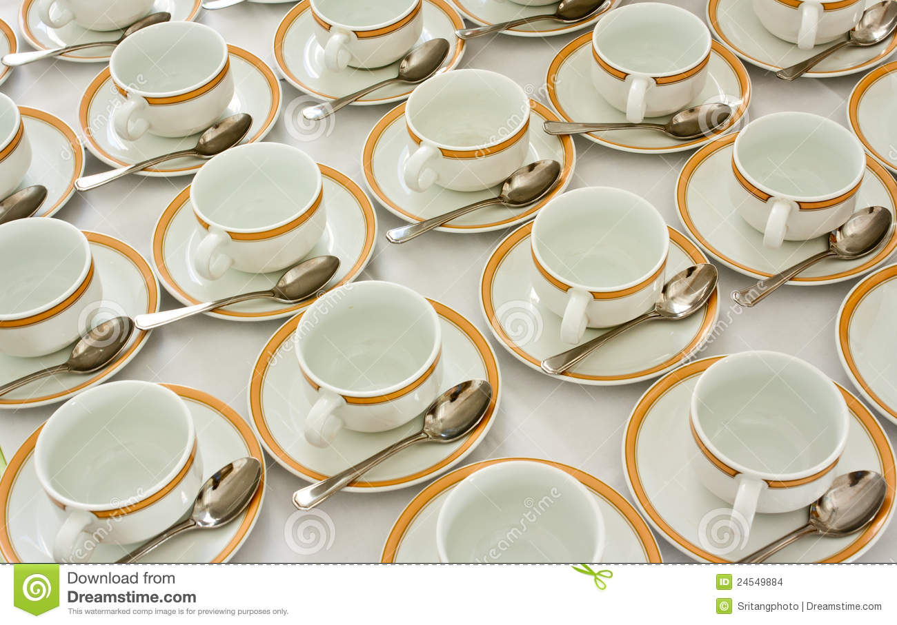 rows of pure cup and saucer with teaspoon royalty free stock photography. Black Bedroom Furniture Sets. Home Design Ideas