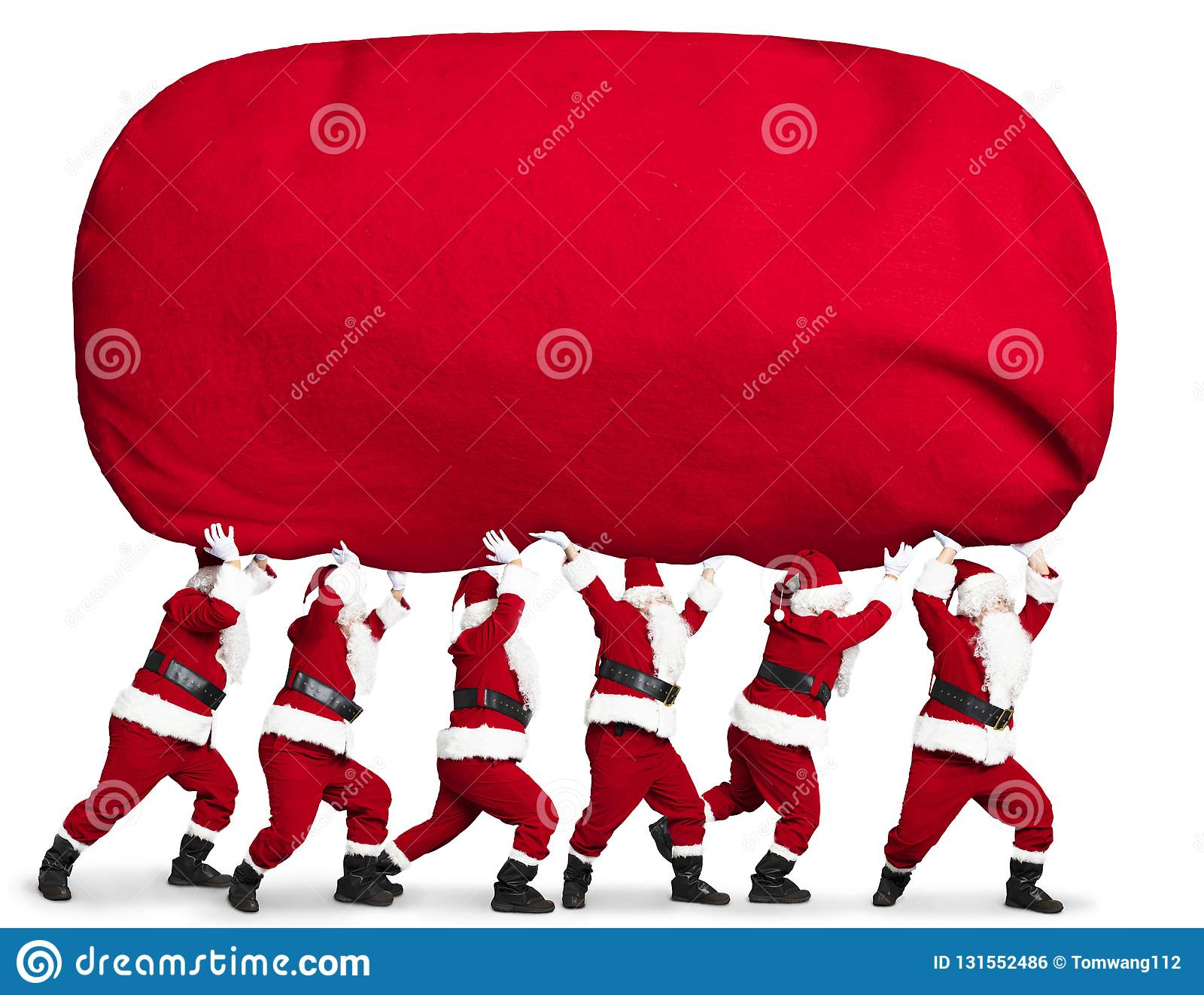 Santa claus carrying big and heavy gift red sack