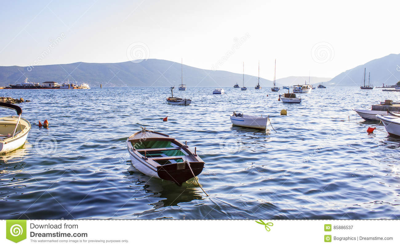 Many small boats on calm water