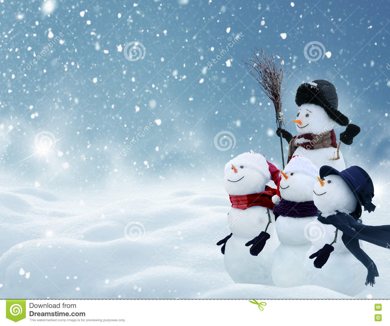 Many snowmen standing in winter Christmas landscape