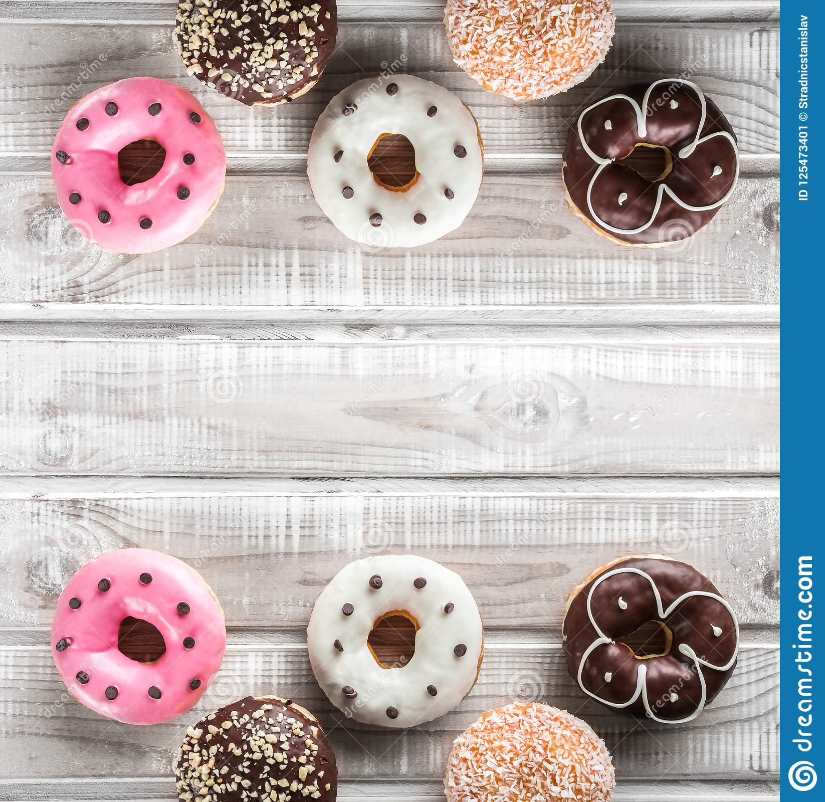 Many sweet donuts on an old wooden table, top view, space for text. Double mirror effect