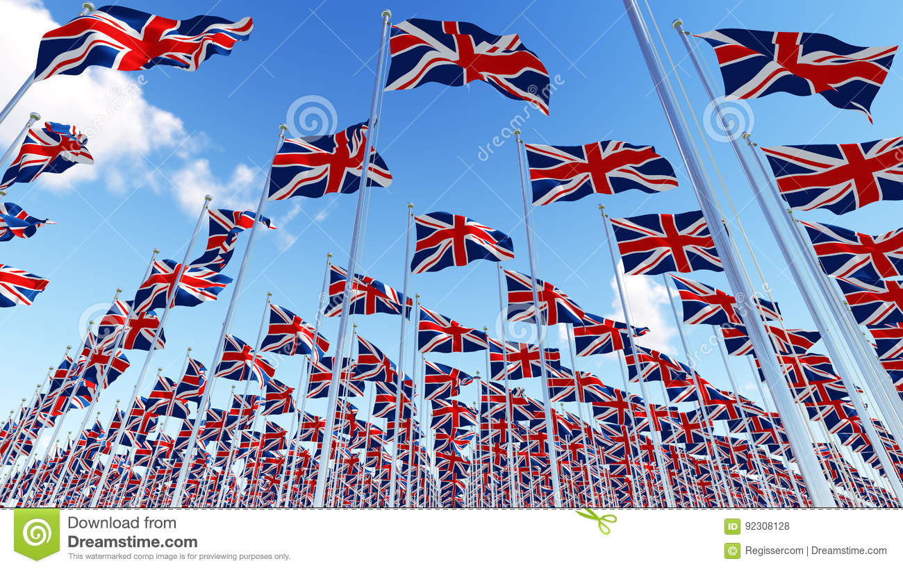 Many United Kingdom flags waving in the wind in blue sky.
