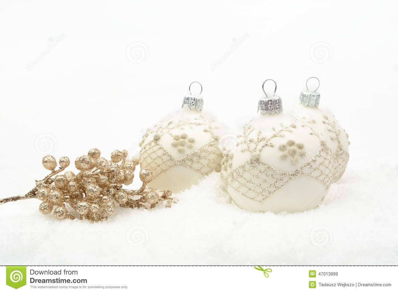 Many white christmas baubles with gold decoration on snow for White christmas baubles