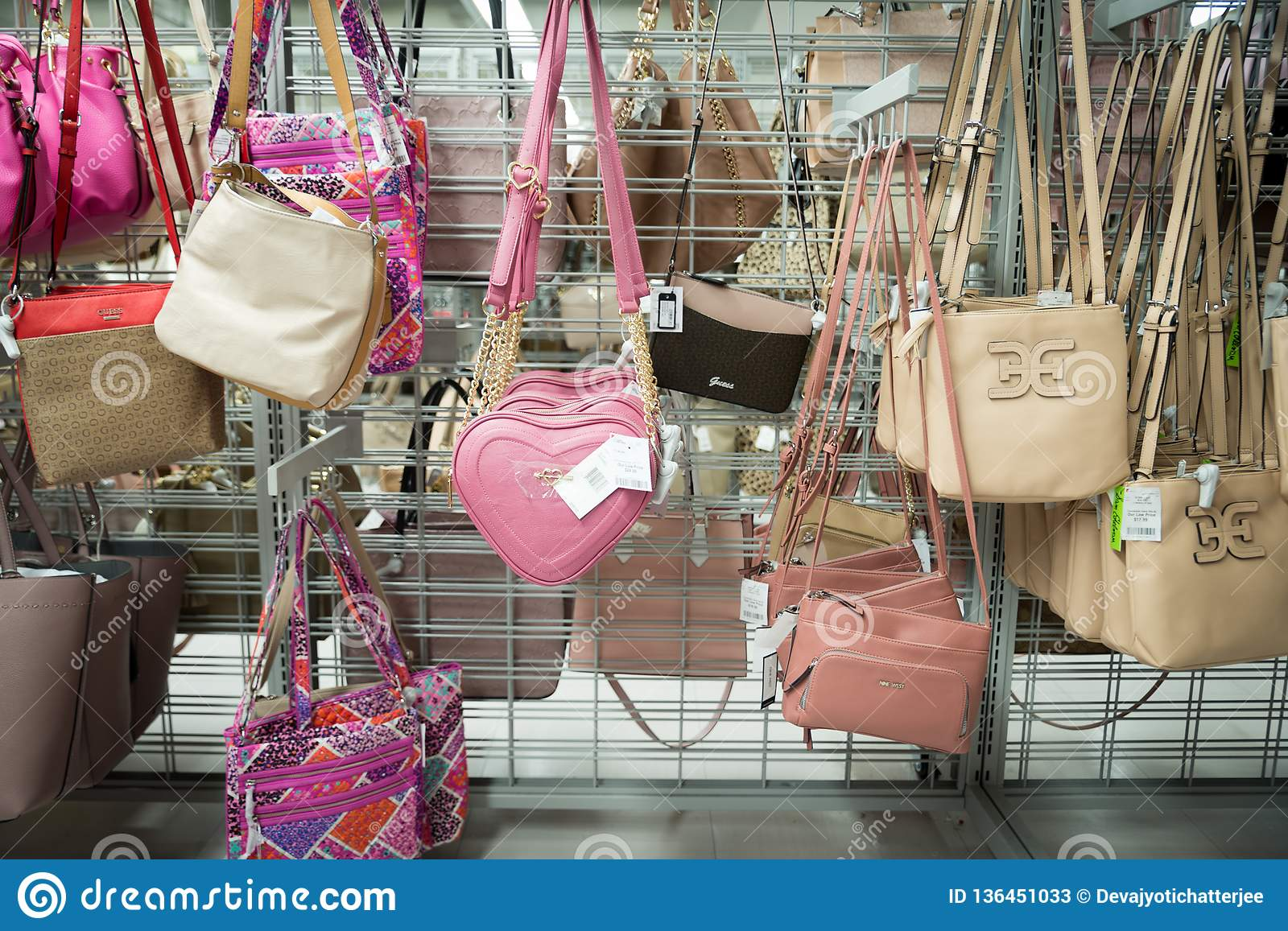 Many womens shoes on a rack at a discount store burlington coat factory. There are stillettos