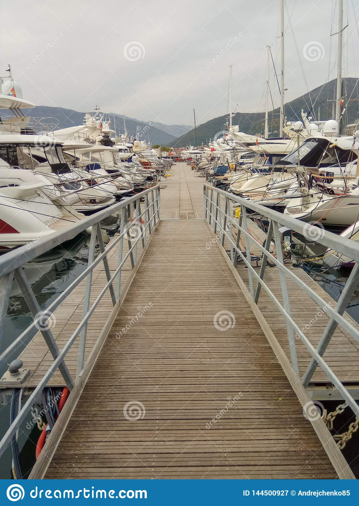 Many yachts in port Tivat, Montenegro, cloudy