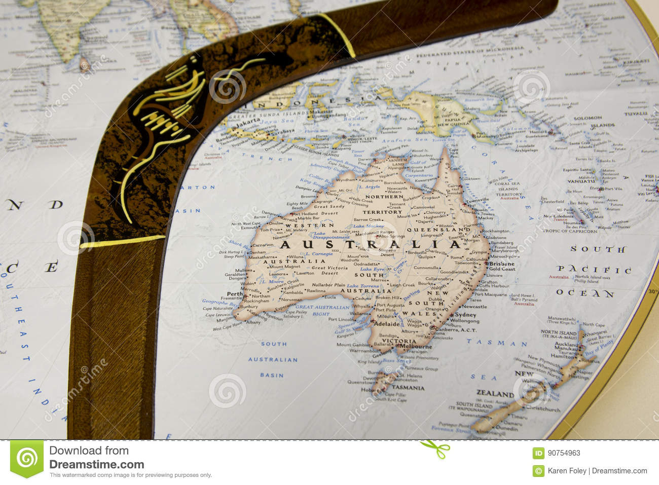 Map of Australia with wooden boomerang