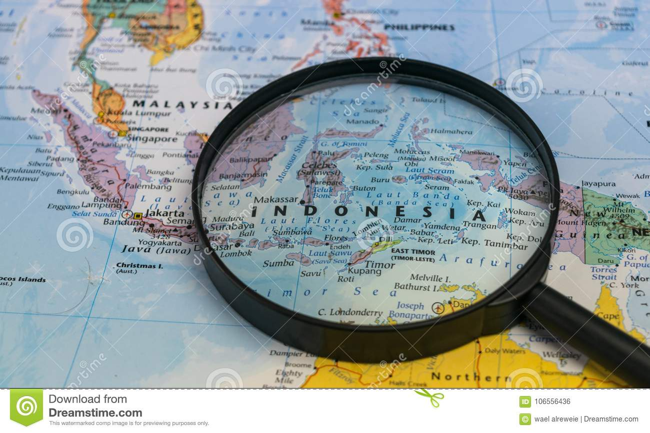 Map of indonesia through magnifying glass on a world map stock royalty free stock photo gumiabroncs Choice Image