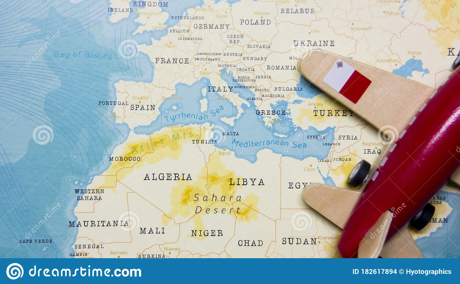 Picture of: A Map Of Malta And A Red Plane With A Flag Of Malta Attached To Its Wings Stock Photo Image Of Island Food 182617894