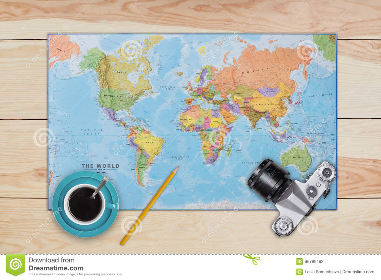 Map old camera cup of coffee and pencil laying on wooden desk map old camera cup of coffee and pencil laying on wooden desk necessary equipment of traveler or tourist top view of traveler baggage and retro camera gumiabroncs Image collections