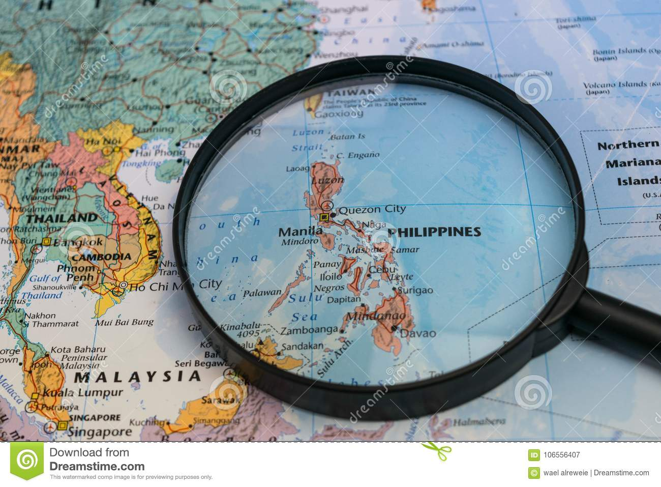 Map of the philippines through magnifying glass on a world map royalty free stock photo publicscrutiny Images